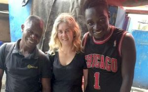 Selassy (Accra project manager), Lorraine van Blerk, and research assistant Jonathan on the streets of Accra, Ghana