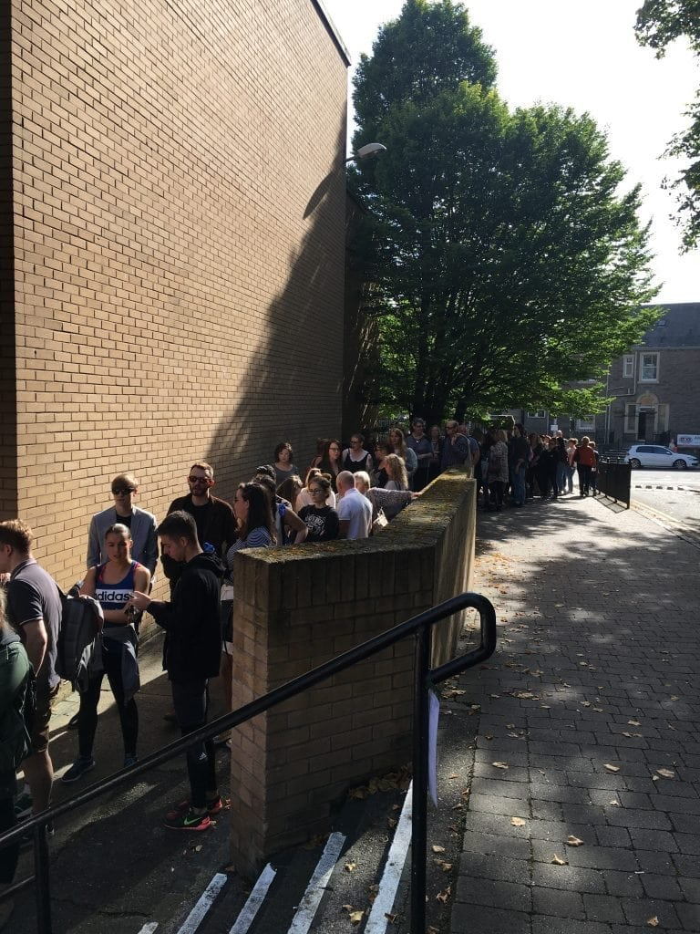 Hordes of people eagerly awaiting entry into the Vintage Weigh and Pay at Bonar hall, University of Dundee