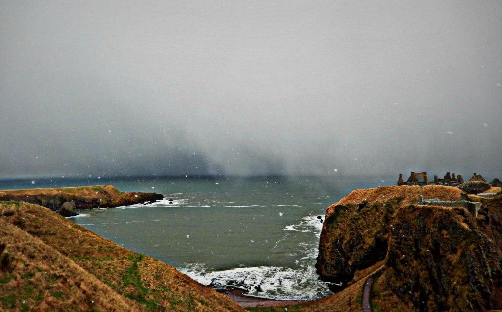 snow storm dunnottar castle - scotland